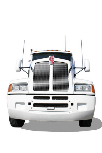 Huge white Truck isolated frontal View Delivery Hauler Icon Isolated Power Traffic Transit Car Day Freight Transportation Freightliner Frontal View Land Vehicle Mode Of Transport No People Parcel Shipment Studio Shot Symbol Trade Transportation Truck White Background