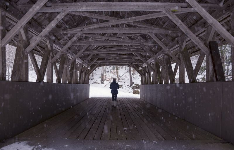 RoMurphyPhotography.com Architecture Built Structure Real People One Person Lifestyles Day Direction Rear View Bridge The Way Forward Leisure Activity Unrecognizable Person Connection Full Length Indoors  Transportation Wood - Material Bridge - Man Made Structure Standing Diminishing Perspective Ceiling