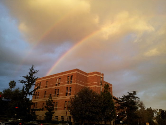 Low angle view of rainbow over building