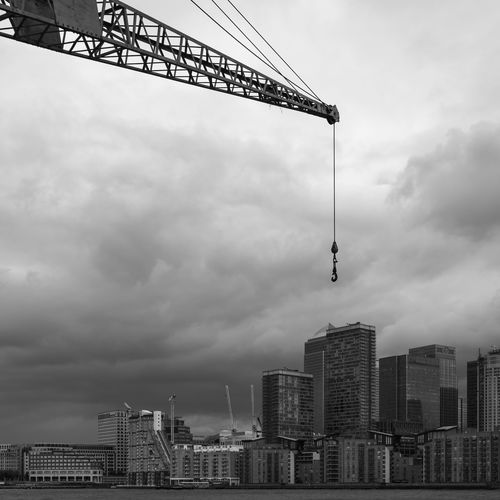A Crane over Canary Wharf from across the thames, London, England Architecture Business Canary Wharf City Cityscape Famous London Modern Office Thames United Kingdom B&w Black And White Building Corporate Crane England English Financial Outdoors River Sky Skyscraper Tower Urban