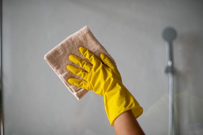 Person holding yellow umbrella