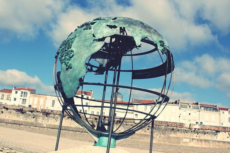 Globe monument at la rochelle against sky