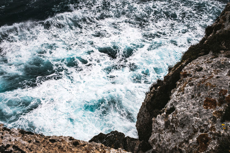 Water Sea Rock Motion Sport Rock - Object Solid Aquatic Sport Beauty In Nature Surfing Wave Nature Splashing Power In Nature Power Rock Formation Day Land Outdoors Breaking Flowing Water Hitting Rough Sea Rough Waters Turquoise Water