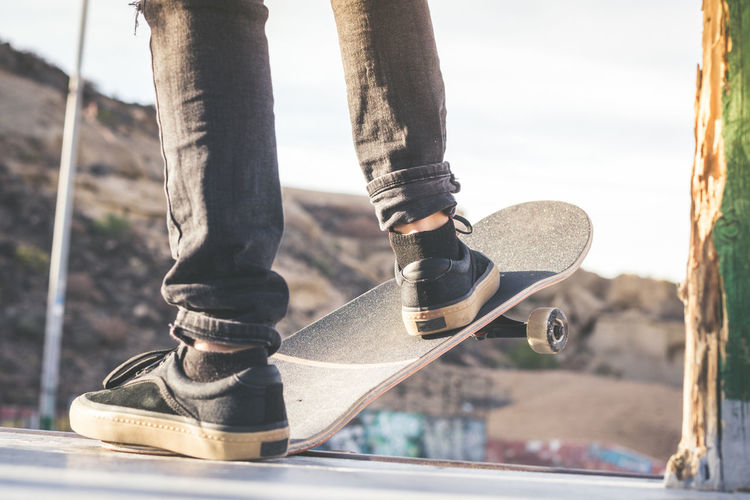 Low section of man with skateboard