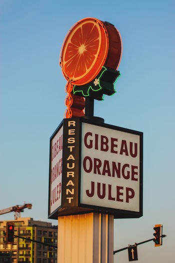 Montreal bites - Gibeau Orange Julep City City Life Gibeau Orange Julep Quebec Tourist Attraction  Travel Architecture Big Orange Building Exterior Built Structure Canada Canada Coast To Coast City Clear Sky Communication Day Guidance Illuminated Information Lighting Equipment Low Angle View Nature No People Outdoors Road Road Sign Sign Sky Sony A68 Street Tamron 70-200mm F/2.8 Text Tourist Destination Travel Destinations Western Script
