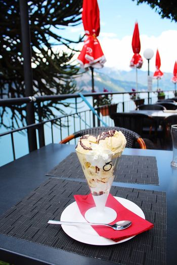 Close-up of ice cream on table in cafe
