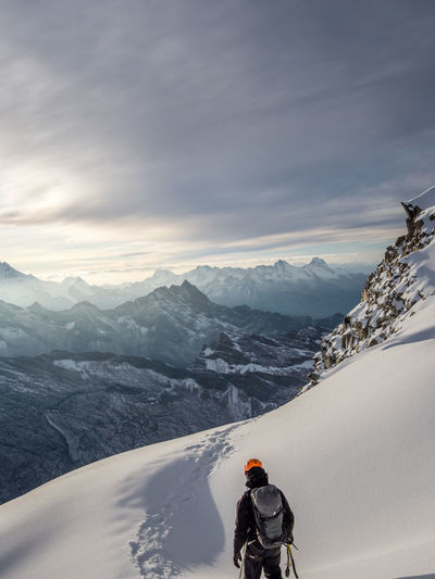 Mountain Winter Snow Cold Temperature Mountain Range Scenics - Nature Beauty In Nature Winter Sport One Person Leisure Activity Sport Sky Adventure Real People Holiday Cloud - Sky Snowcapped Mountain Vacations Environment Warm Clothing Outdoors