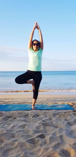 Yoga and meditation for relaxation at beach in tranquillity