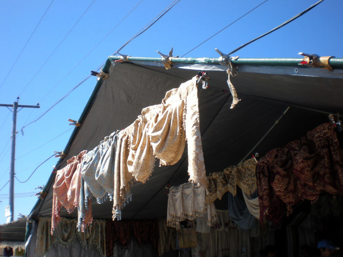 Blue Clothesline Curtain Low Angle View Market Stall Open Air Outdoors Pleinair Sky Telephone Pole Tent