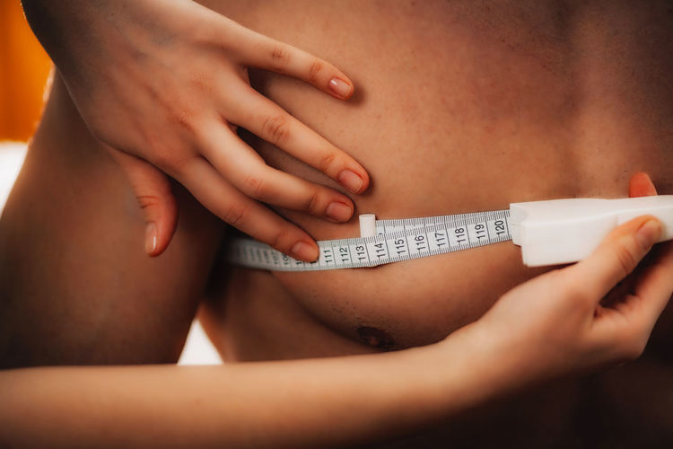 Measuring Body Circumference with Measurement Tape Measurement Measurement Tape Tape Measuring Tight Circumference Fat Measure Anatomy Diet Healthy Exercise Health Skinfold Mass Man Lifestyle Waist Weight Thickness Test Skin Equipment Medical Body Part Check Muscle Fitness Waistline Shape Slim Fit Trainer Healthcare Layer Adult Anthropometric Measurement Nutrition Status Exercising Health Club Healthcare And Medicine Healthy Lifestyle Human Body Part Athlete Human Hand Holding Indoors