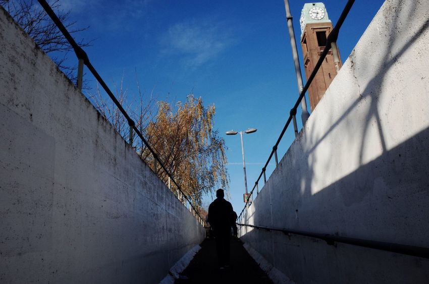 Commuting Walking Prospective Urban Tower One Person Sky Lifestyles Outdoors One Man Only Day Blue Sky Walking Alone... Listed Building Underpass Transportation Morning London Syon Lane Rear View