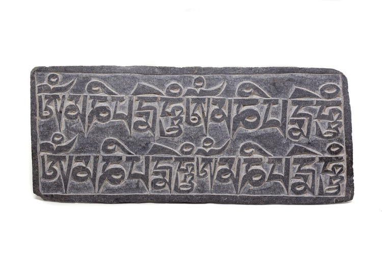 Mani Stone on white background Buddha Buddhism Carved Stones Carving Himalayas Inscription Kathmandu Mani Mani Stone Mantra Mantras Meditation Nepal OM Om Mani Padme Hum Prayer Sanskrit Stone Text Tibet Tibetan  Tibetan Buddhism White
