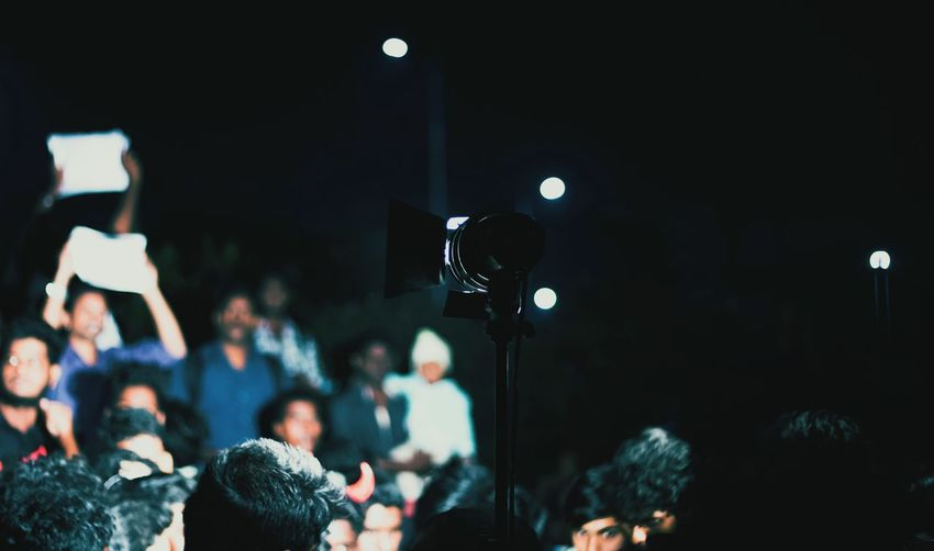 Getting into the spotlights... Arts Culture And Entertainment Photography Themes People Adult Photographing Night Adults Only Microphone Camera - Photographic Equipment Men The Media Young Adult Outdoors Young Women Popular Music Concert Only Men Social Issues Protest Chennai Selective Focus Darkness And Light Lowlight Dark Nightphotography Depth Of Field