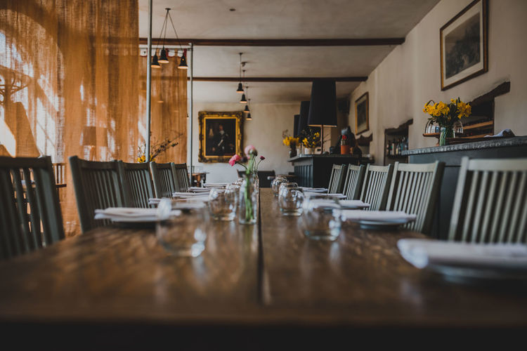Absence Arrangement Business Chair Day Empty Food And Drink Furniture Glass Home Interior Indoors  No People Place Setting Plate Restaurant Seat Selective Focus Setting Still Life Surface Level Table Technology Wood - Material