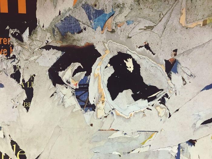 High angle view of damaged graffiti on wall