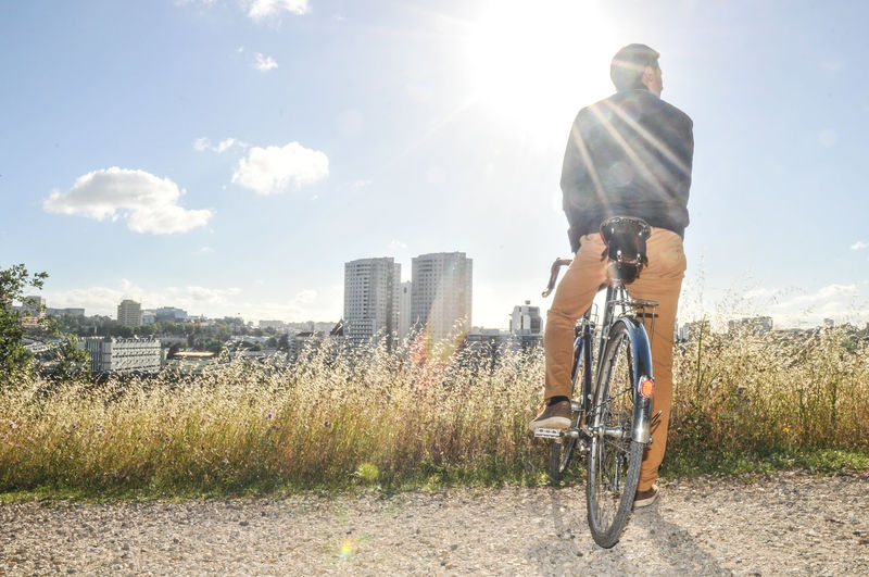 Lens Flare Only Men One Man Only Sunbeam Sky One Person Sunlight Adults Only Adult Outdoors Full Length Day Bicycle Casual Clothing Rear View Mature Adult People Men Light Beam Motion