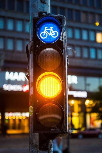 Illuminated Bicycle Sign On Stoplight