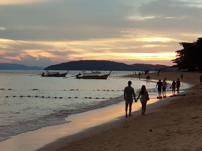 Railay Beach, Thailand Silhouette Mobile Photography Sunset_collection Scenery Shots Samsungphotography Nofilter Mobilephotography Thailand Landscape_photography Landscape_Collection Sea Beach Land Water Sky Sunset Group Of People Real People Cloud - Sky Nature Beauty In Nature People Walking Orange Color Sand Outdoors Scenics - Nature