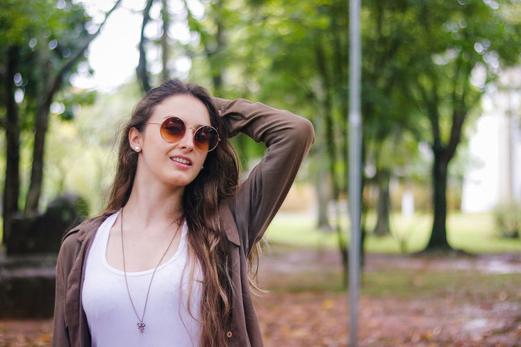 Beautiful Woman Beauty Day Front View Happiness Long Hair Nature One Person Outdoors People Portrait Smiling Sunglasses Tree Young Adult Young Women