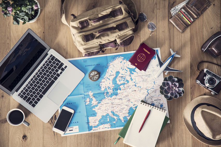Lets Go  Travel Adventure Book Communication Connection Desk Discovery High Angle View Indoors  Laptop Letsgosomewhere Map No People Paper Passeport Publication Table Technology Travel Destinations Wood - Material