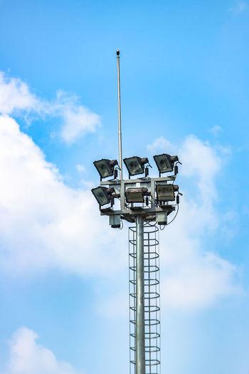 Outdoor floodlight pole for sport stadium public park Architecture Blue Built Structure Cloud - Sky Day Electric Pole Floodlight Pole Low Angle View No People Outdoor Outdoors Sky Sport Stadium Technology