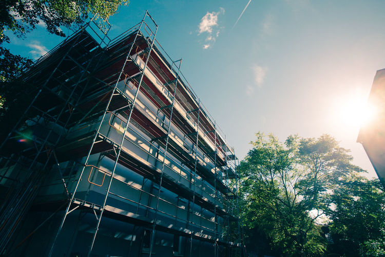 Bright Construction Scaffolding Architecture Building Exterior Built Structure City Concept Day Low Angle View Modern No People Outdoors Sky Sunlight Symbolic  Tree