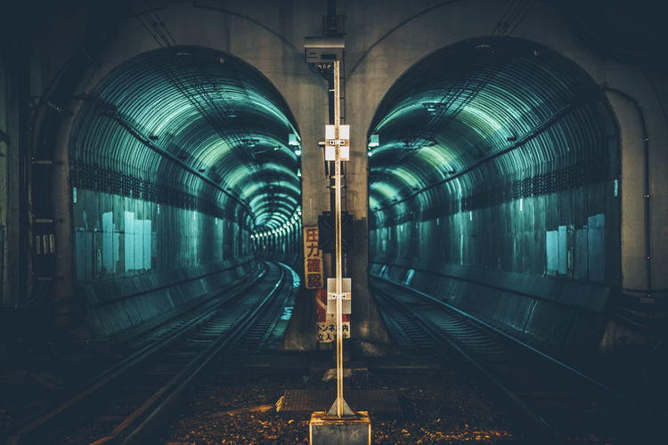 View of illuminated railroad tunnel