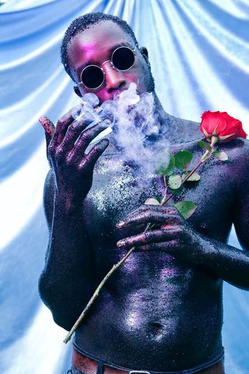 """Cupid"". Model: Umar Shareef Velvet Smoking Rosé Body Paint Glitter Sunglasses Fashion One Person Glasses Real People Portrait Front View Outdoors Men Human Body Part Waist Up Mid Adult Day Adult"