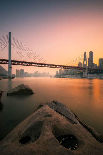 Chongqing City Bridge Built Structure Bridge - Man Made Structure Architecture Water Connection Sky Engineering River Transportation Suspension Bridge Sunset Travel Destinations Tourism Nature Travel City Bay Outdoors Skyscraper Cityscape Office Building Exterior