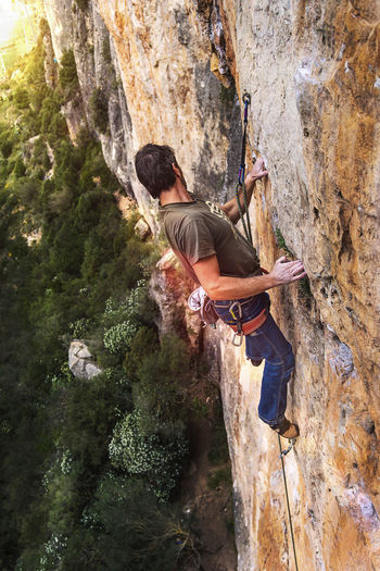 Rock Rock Formation Climbing Rock Climbing Extreme Sports Sport Adventure Outdoors Effort Activity Climber Sport Climbing Determination Catalonia Lleida Climb Alpinism Mountain Limestone Dare European  40-50 Years Rope Harness Safety Safety Equipment Climbing Equipment