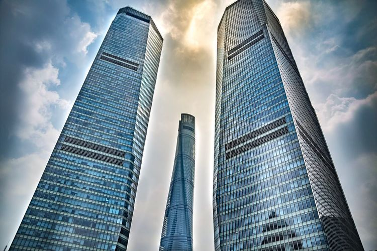 In the middle Architecture Built Structure Sky Low Angle View Tall - High Office Building Exterior Building Exterior Skyscraper Cloud - Sky City Building Office Tower Modern No People Glass - Material The Architect - 2018 EyeEm Awards