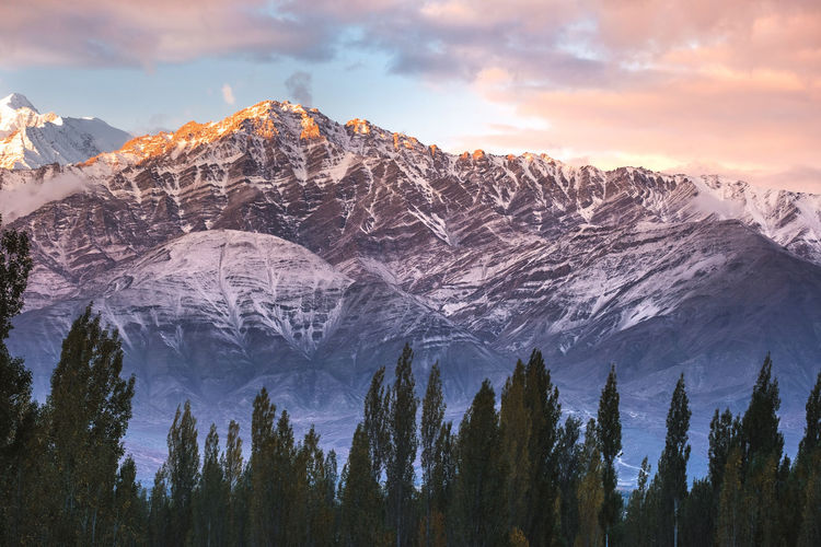 Scenic view of snowcapped mountain during sunset