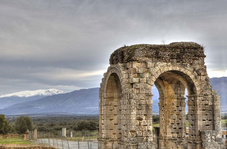 Roman Arch of Caparra with snowy mountains at bottom, Caceres, Spain Ancient Arch Architecture Cloud - Sky Day History Landscape Medieval Mountain No People Old Ruin Outdoors Scenics Sky Travel Destinations