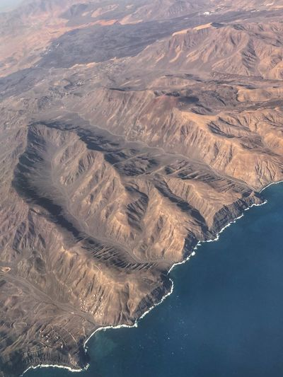 Aerial view of sea and mountains
