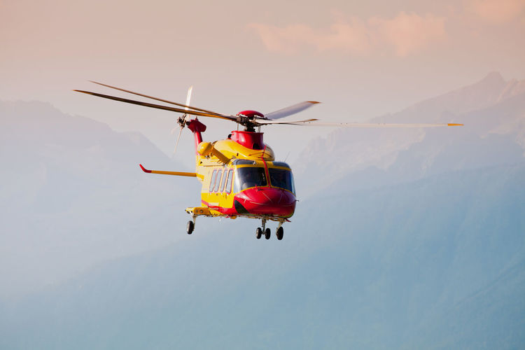 View of helicopter flying in sky