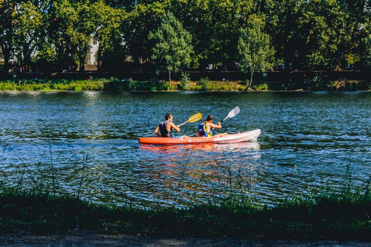 Friends Kayaking In Lake