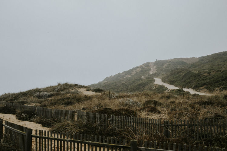 Mountain Landscape Copy Space No People Beauty In Nature Fence Outdoors Land Environment Morning Early Morning Fog Beach Foggy Morning
