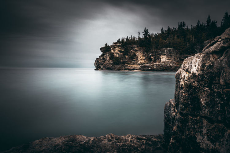 Indian Head Cove Beauty In Nature Scenics - Nature Rock Water Tranquility Sky Tranquil Scene Rock - Object Solid Sea Nature No People Rock Formation Day Land Cliff Cloud - Sky Non-urban Scene Outdoors Eroded Tobermory Bruce Peninsula Ontario Canada Indian Head Cove Grotto Turquoise Lake Huron Camping Wildlife Trail Hiking Long Exposure Nikon D7500 Explore Discover Your City Adventure EyeEm Best Shots EyeEmNewHere