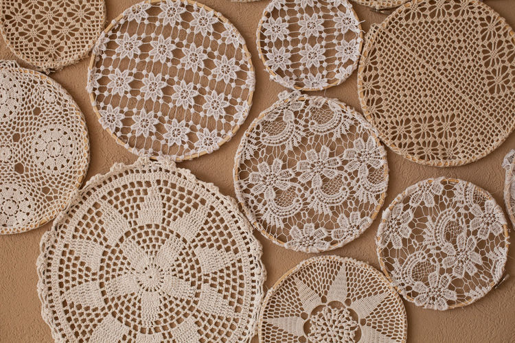 A lot of different laces with all kind of symmetry Backgrounds Circle Close-up Decoration Handcraft Handmade Knitting Lace - Textile No People Pattern Symbols Symmetry Textile