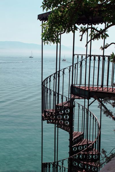 Stair case to the sea Aesthetic Staircase Ocean Staircase To The Sea Water Sea Nature Day Sky Beauty In Nature No People Metal Architecture Outdoors Railing