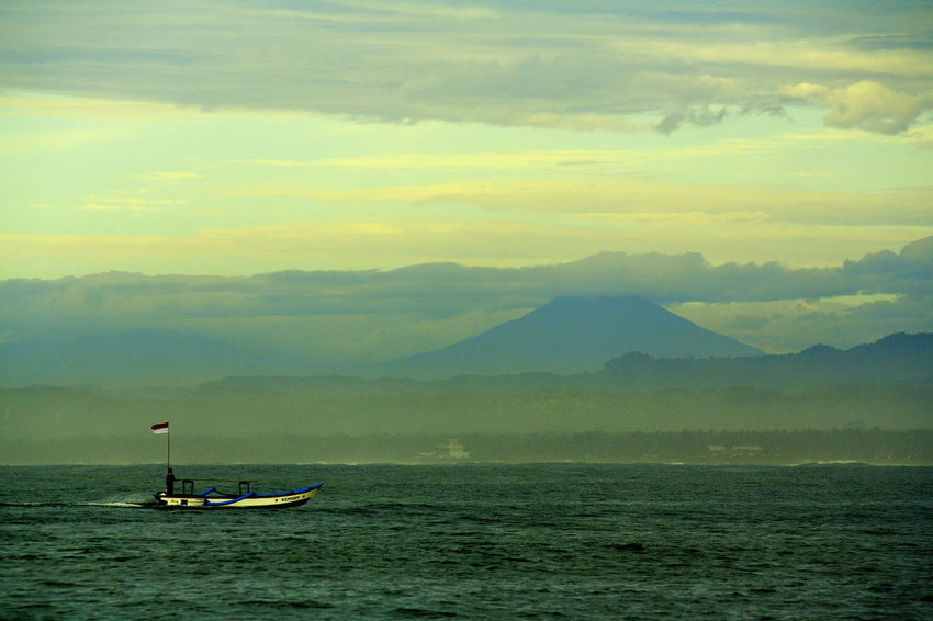 Mount Cikuray as seen from Pangandaran Beach Beach Beachphotography Beauty In Nature Day Men Mount Cikuray Mountain Nature Nautical Vessel Outdoors Pangandaran Pangandaran Beach People Scenics Sky Transportation Water Summer Sports