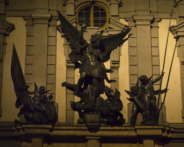 Archangel Michael Architecture Art Art History Building Exterior Illuminated Night Outdoors Putti Satan Sculpture Statue Travel Destinations Zeughaus