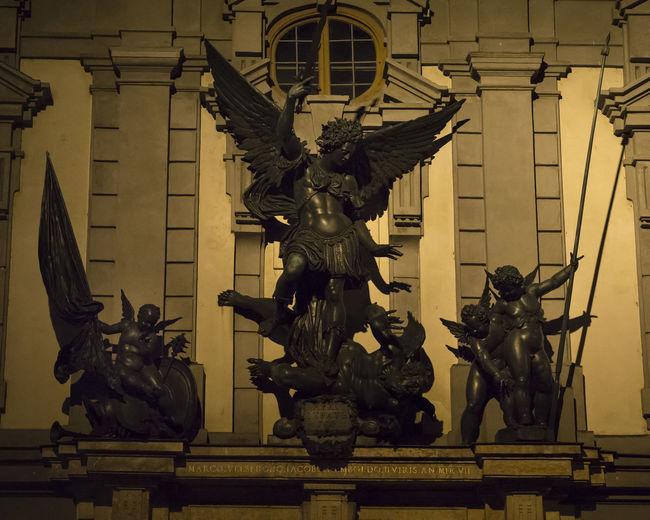 Archangel Michael Architecture Art Art History Building Exterior Illuminated Night Outdoors Putti Satan Sculpture Statue Travel Destinations Zeughaus