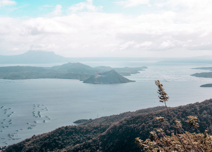 Taal Volcano Beauty In Nature Cloud - Sky Day Environment High Angle View Idyllic Landscape Mountain Nature No People Non-urban Scene Outdoors Rock Scenics - Nature Sea Sky Tranquil Scene Tranquility Water