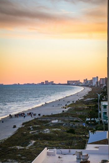 Myrtle beach sunset Sunset Sea Beach No People Water Landscape Business Finance And Industry Sky Outdoors Built Structure Horizon Over Water Architecture City Nature Day Modern Camera - Photographic Equipment Canon70d Freshness Fineart_photo Travel Destinations Springtime Skyscraper Power In Nature Beauty In Nature
