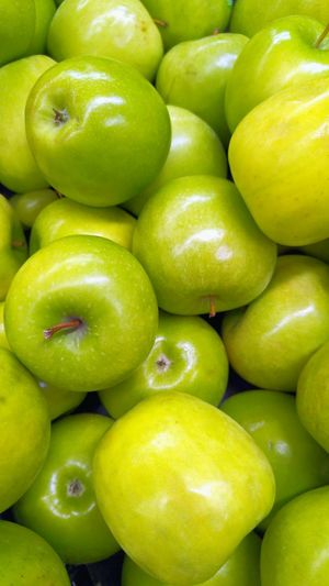 Full frame shot of granny smith apples in market