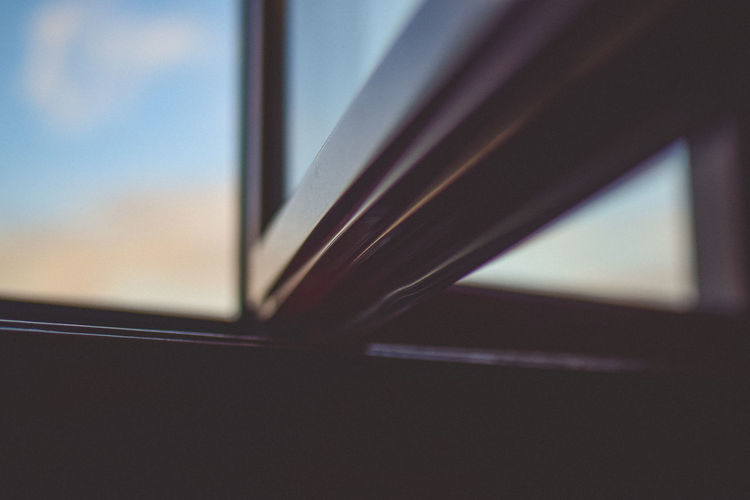 Close-up of window against sky