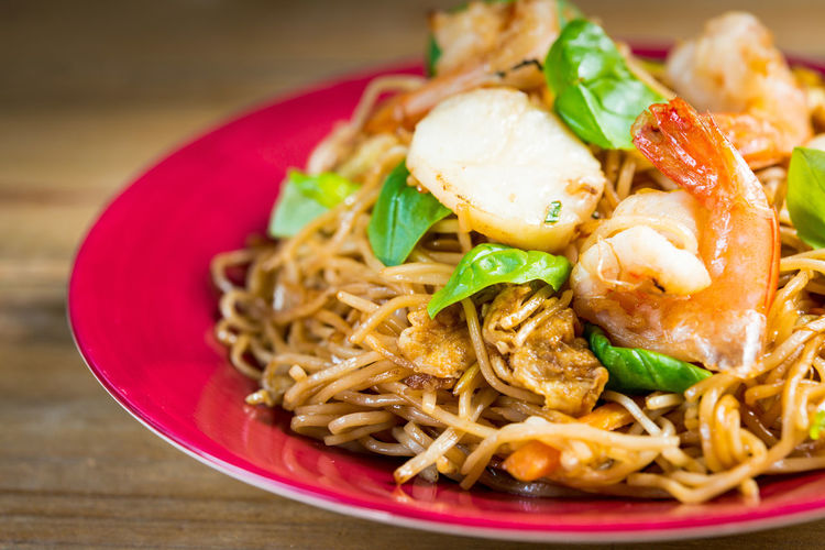 Close-up of shrimp and noodles served in plate on table
