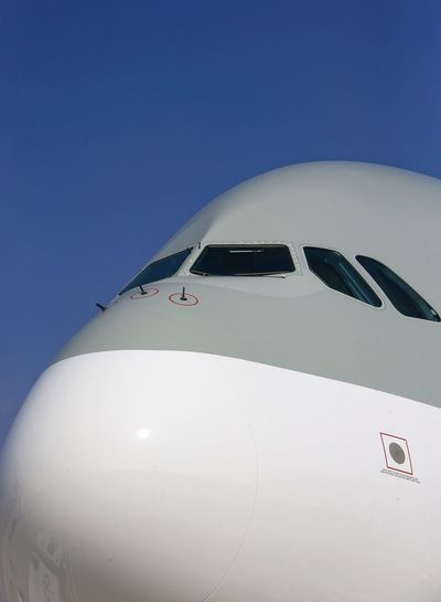 Low angle view of airbus a380 against clear blue sky