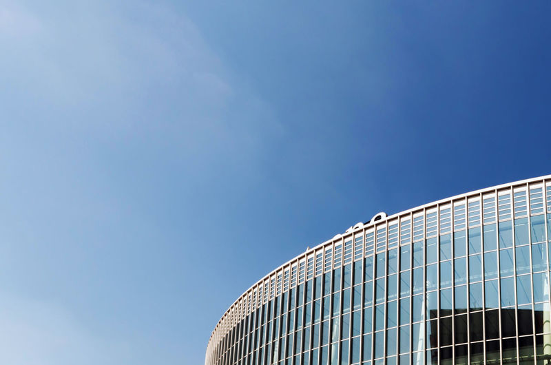 Office Building Exterior Glass - Material Sport City Building Sunlight Outdoors No People Blue Clear Sky Day Copy Space Nature Low Angle View Modern Building Exterior Architecture Built Structure Sky Pattern My Best Photo
